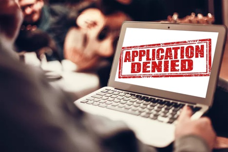 selective focus on laptop screen showing application denied
