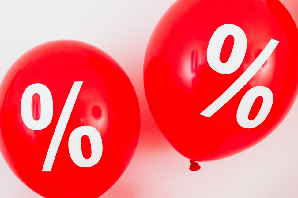 red balloons with percentage symbols on them.