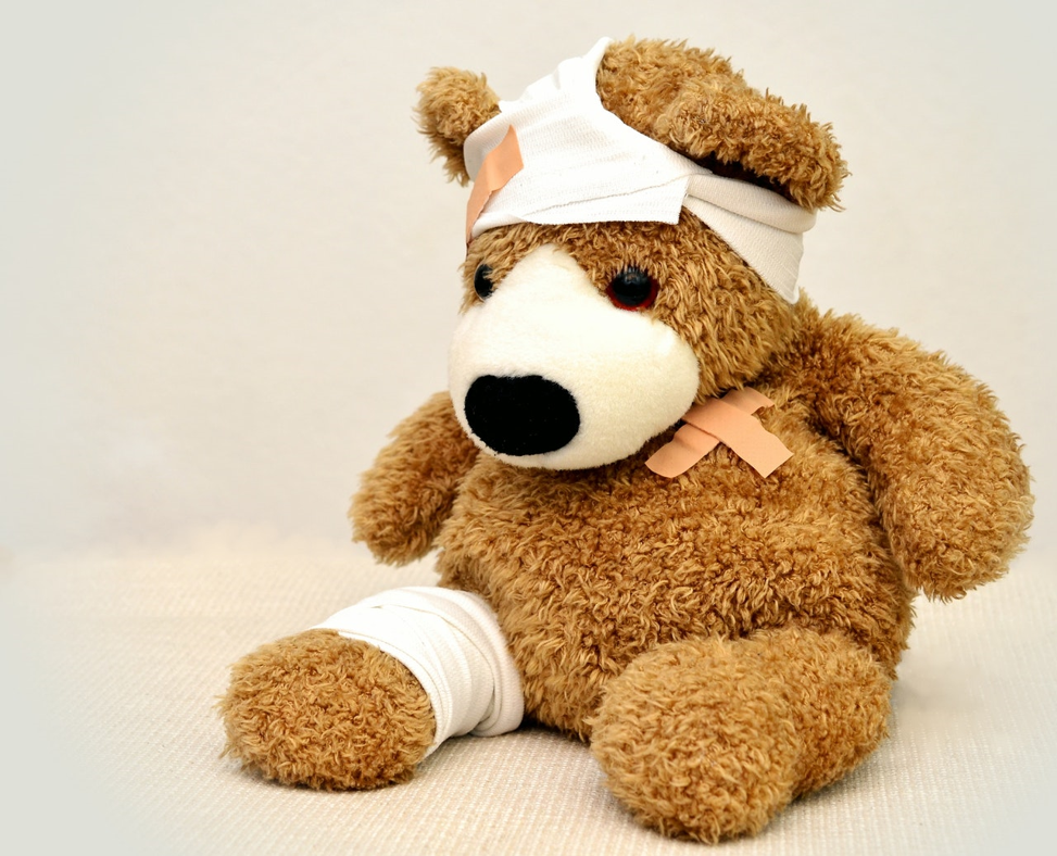 Stuffed bear who needs a personal loan to help pay for his medical bills.