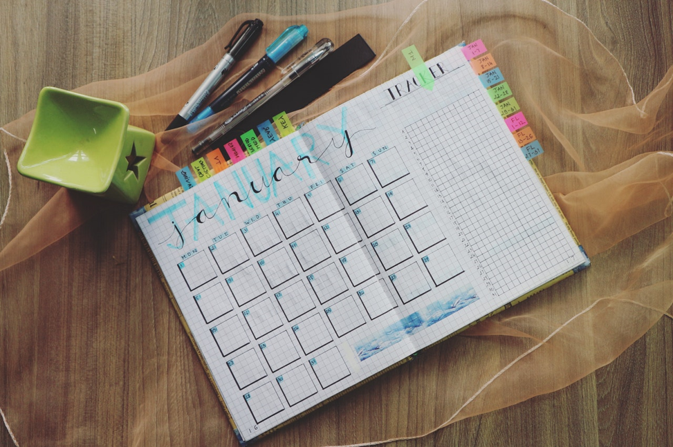 Monthly budget calendar on a table.