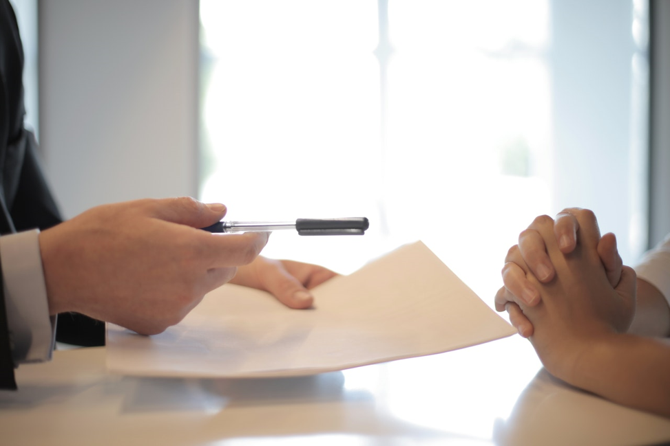 person signing a personal loan contract.