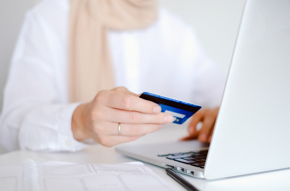 Person doing some online shopping with their credit card/