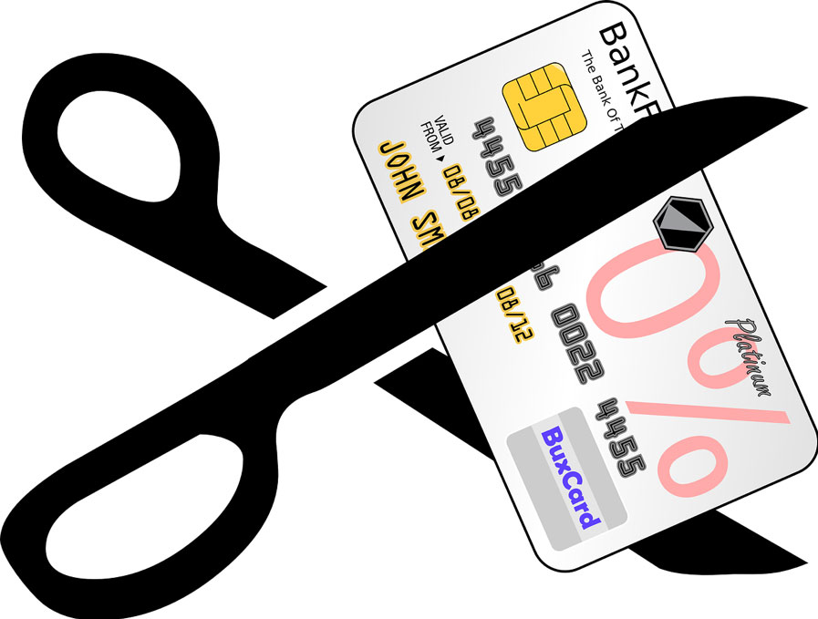 Graphic image of a credit card being cut by a pair scissors
