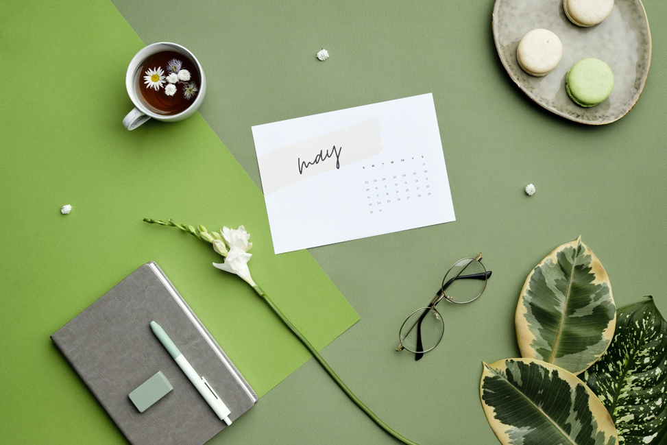 Calendar with month of may open on green table