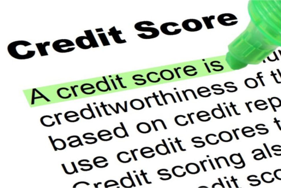Highligting definition of credit score with a green marker