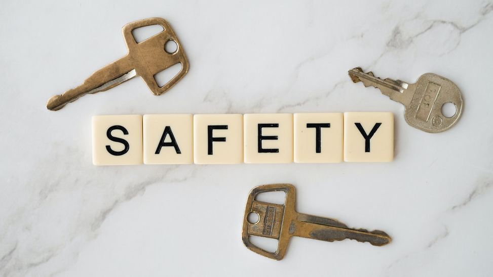 "keys surrounding scrabble pieces spelling out ""safety""."