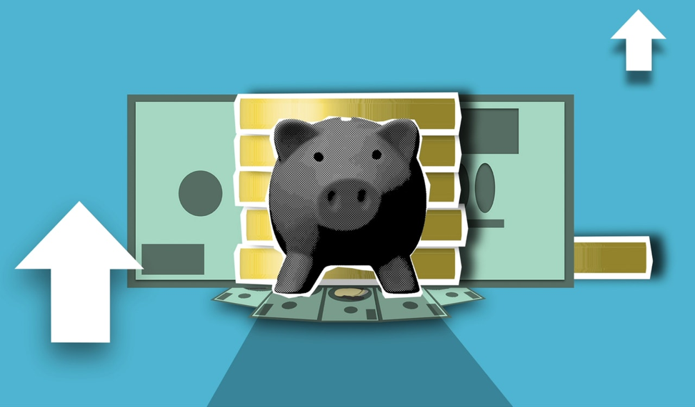 piggy bank in front of stack of coins.
