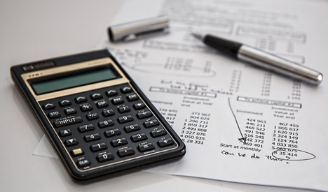 Monthly expenses report and black calculator