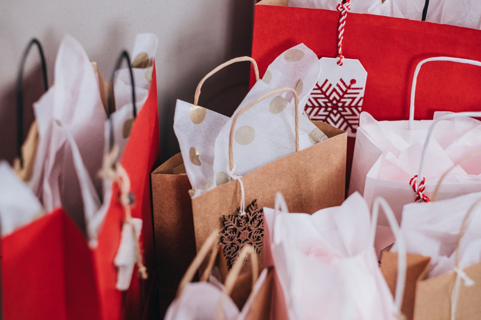 red and brown bags with tissue paper filling