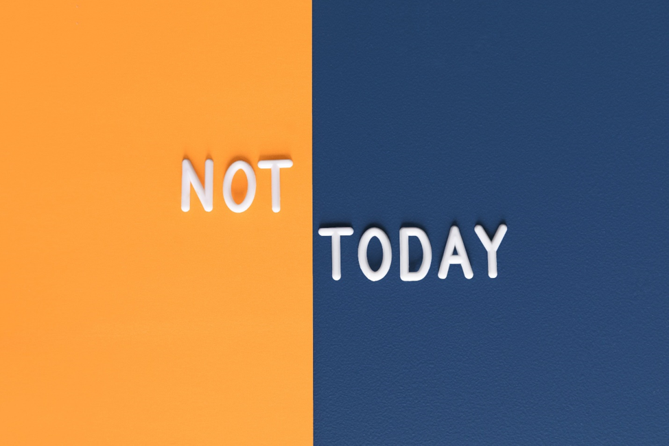 the word not in white lettering on orange background next to word today in white lettering on blue background