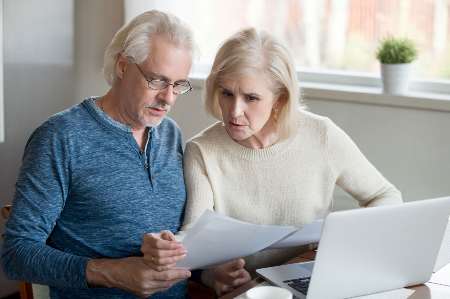 Older couple looking at their loan documents