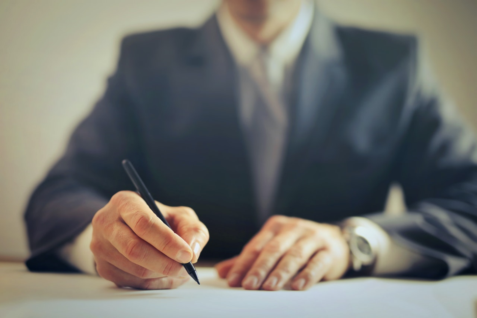 Person signing installment loan contract.