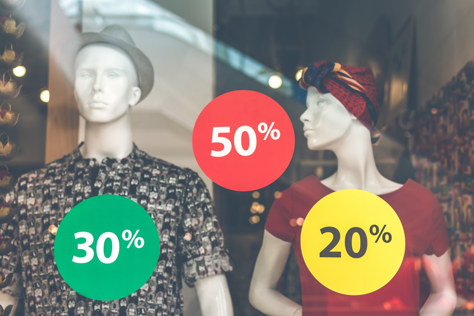 Store window with 50% 30% and 20% symbols