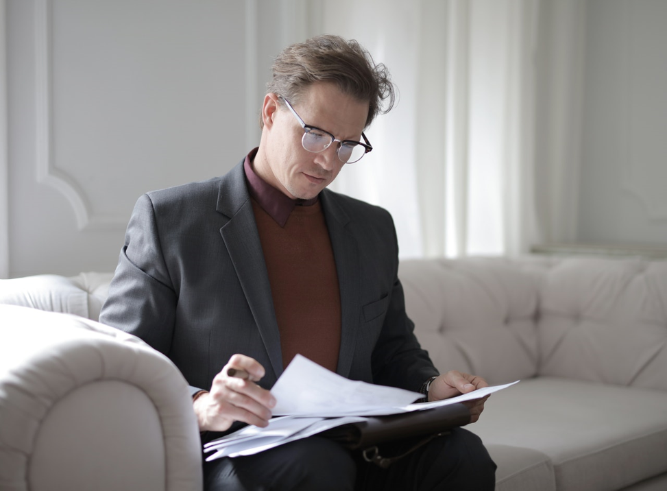 Person looking at documents about to apply for a personal loan