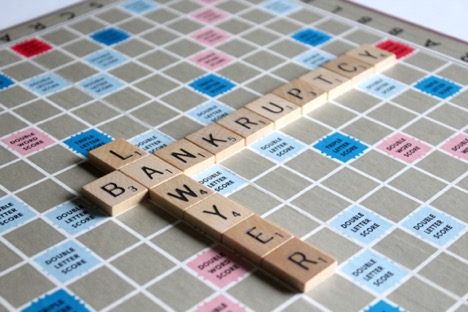 Scrabble board with the words bankruptcy and lawyer intersecting