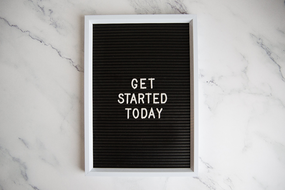 get started today on a white-framed letter board on marble surface