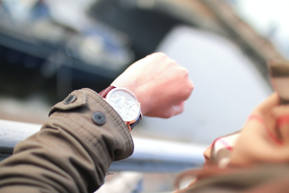 person looking at their watch on their wrist.